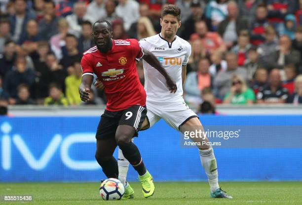 Romelu Lukaku of Manchester United is challenged by Federico Fernandez of Swansea City during the Premier League match between Swansea City and...