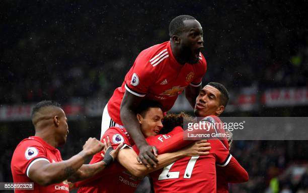Romelu Lukaku of Manchester United joins the celebration as Marouane Fellaini of Manchester United scroing his side's third goal during the Premier...