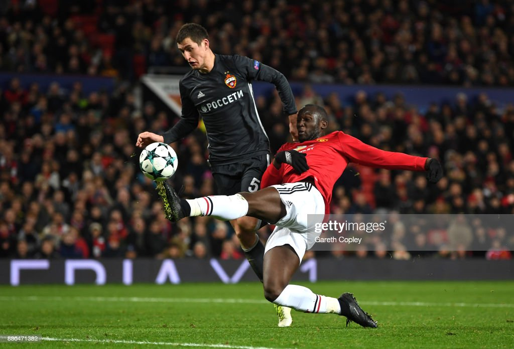 Romelu Lukaku of Manchester United scores his sides first goal while under pressure from Viktor Vasin of CSKA Moscow during the UEFA Champions League group A match between Manchester United and CSKA Moskva at Old Trafford on December 5, 2017 in Manchester, United Kingdom.
