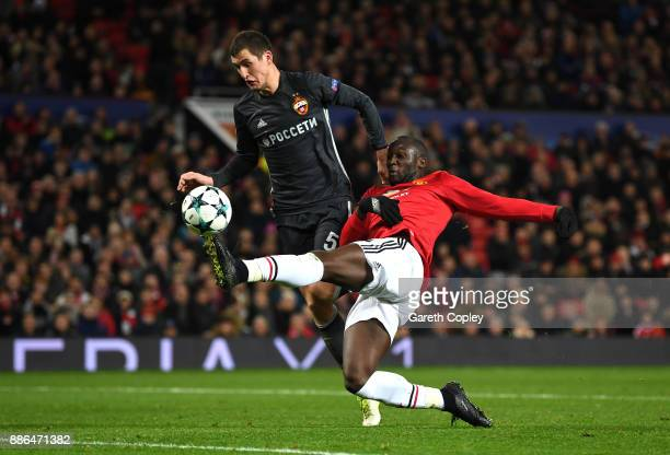 Romelu Lukaku of Manchester United scores his sides first goal while under pressure from Viktor Vasin of CSKA Moscow during the UEFA Champions League...
