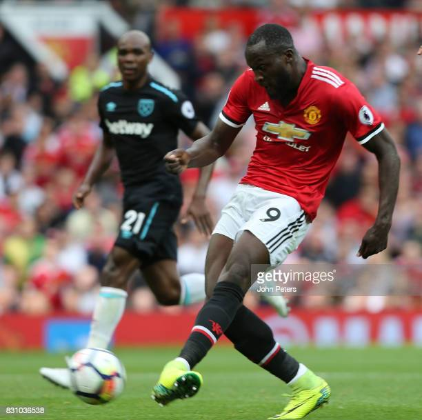 Romelu Lukaku of Manchester United scores their first goal during the Premier League match between Manchester United and West Ham United at Old...