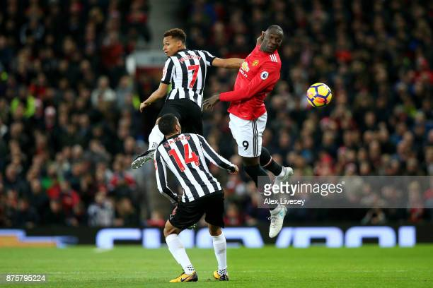 Romelu Lukaku of Manchester United wins a header infront of Jacob Murphy of Newcastle United during the Premier League match between Manchester...