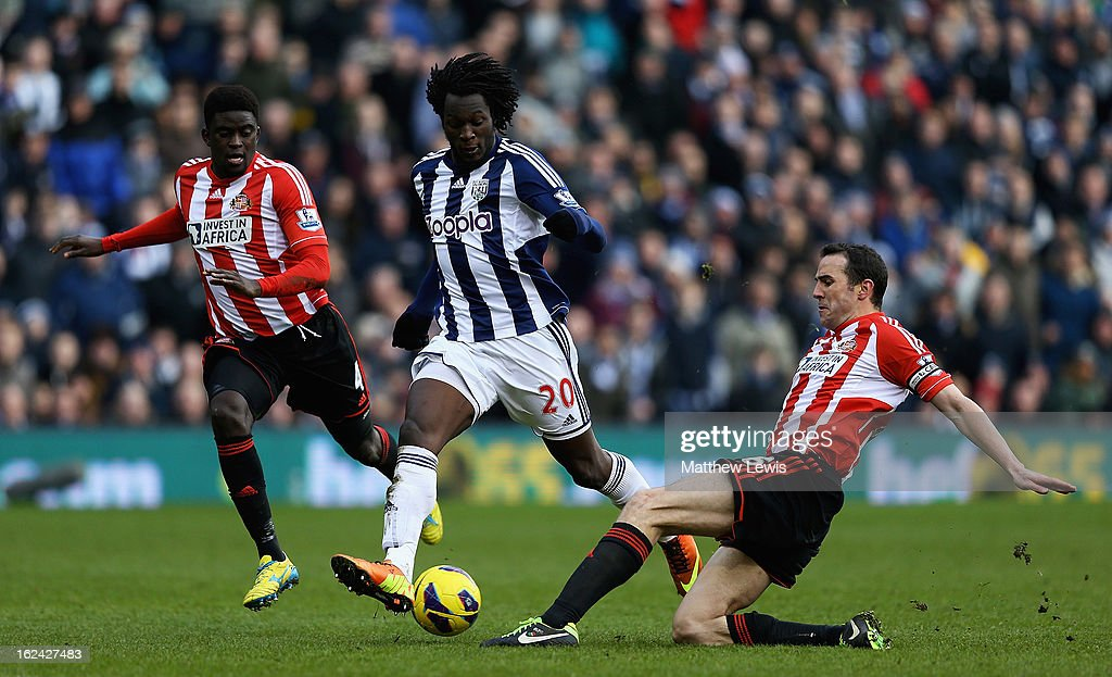 <a gi-track='captionPersonalityLinkClicked' href=/galleries/search?phrase=Romelu+Lukaku&family=editorial&specificpeople=6342802 ng-click='$event.stopPropagation()'>Romelu Lukaku</a> of West Bromwich Albion is tackled by <a gi-track='captionPersonalityLinkClicked' href=/galleries/search?phrase=John+O%27Shea+-+Soccer+Player&family=editorial&specificpeople=202487 ng-click='$event.stopPropagation()'>John O'Shea</a> of Sunderland during the Barclays Premier League match between West Bromwich Albion and Sunderland at The Hawthorns on February 23, 2013 in West Bromwich, England.