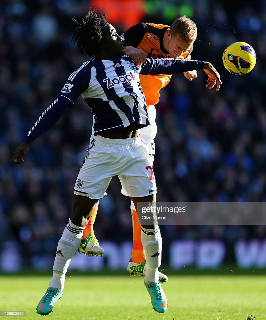 Romelu Lukaku of West Bromwich Albion tackles Brede Hangeland of Fulham during the Barclays Premier League match between West Bromwich Albion and Fulham at The Hawthorns, on January 1, 2013 in West Bromwich, England.