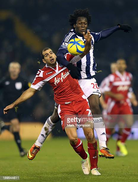 Romelu Lukaku of West Bromwich Albion tangles with Tal Ben Haim of Queens Park Rangers during the FA Cup third round replay between West Bromwich...