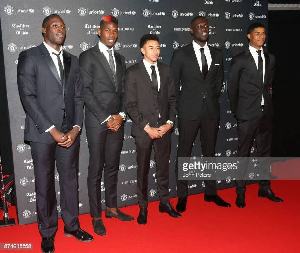 Romelu Lukaku Paul Pogba Jesse Lingard singer Stormzy and Marcus Rashford of Manchester United attend the annual United for UNICEF gala dinner at Old...