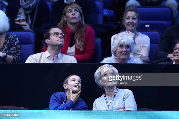 Romeo Beckham and grandmother Sandra Georgina West watch the action courtside during the men's singles semi final between Andy Murray of Great...