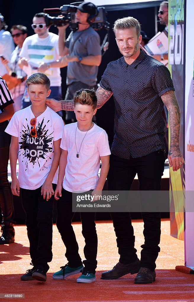 <a gi-track='captionPersonalityLinkClicked' href=/galleries/search?phrase=Romeo+Beckham&family=editorial&specificpeople=171832 ng-click='$event.stopPropagation()'>Romeo Beckham</a>, <a gi-track='captionPersonalityLinkClicked' href=/galleries/search?phrase=Cruz+Beckham&family=editorial&specificpeople=4337497 ng-click='$event.stopPropagation()'>Cruz Beckham</a> and <a gi-track='captionPersonalityLinkClicked' href=/galleries/search?phrase=David+Beckham&family=editorial&specificpeople=158480 ng-click='$event.stopPropagation()'>David Beckham</a> arrive at the Nickelodeon Kids' Choice Sports Awards 2014 on July 17, 2014 in Los Angeles, California.