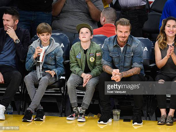 Romeo Beckham Cruz Beckham and David Beckham attends a basketball game between the Boston Celtics and the Los Angeles Lakers at Staples Center on...
