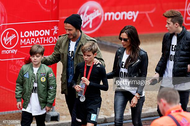 Romeo Beckham receives the support of his family brother Cruz Beckham father David Beckham mother Victoria Beckham and brother Brooklyn Beckham after...