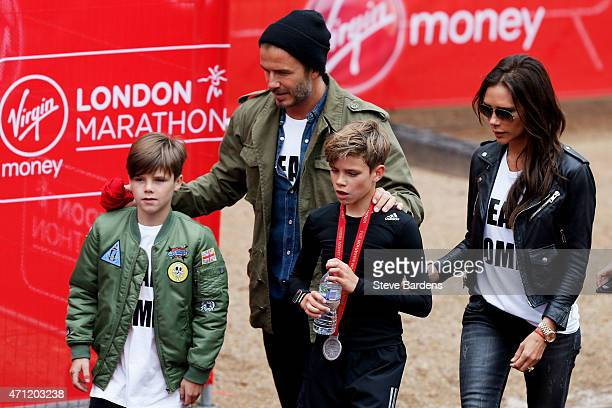 Romeo Beckham receives the support of his family brother Cruz Beckham father David Beckham and mother Victoria Beckham after taking part in the...