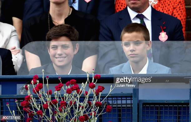 Romeo Beckham son of former football David Beckham watches on during the mens singles final between Feliciano Lopez of Spain and Marin Cilic of...