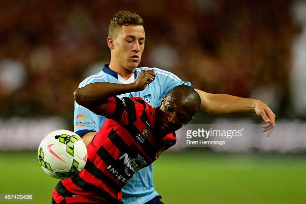 Romeo Castelen of the Wanderers and Alex Gersbach of Sydney FC contest the ball during the round two ALeague match between Sydney FC and the Western...