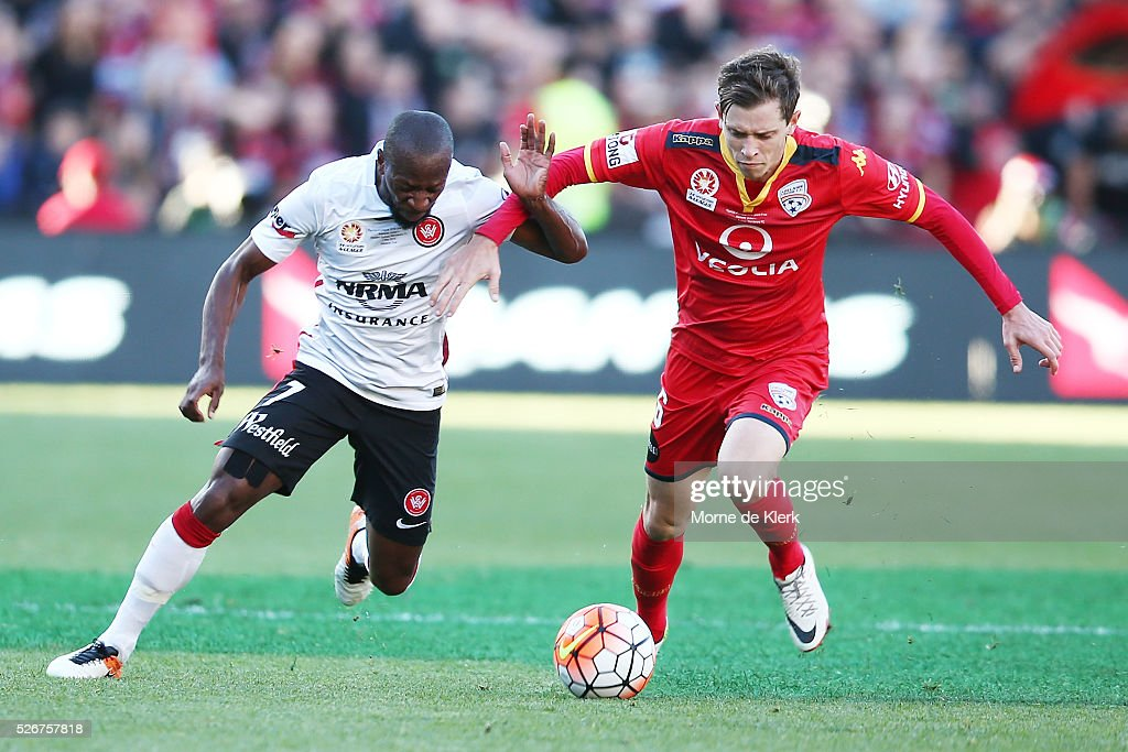 Romeo Castelen of the Wanderers and Craig Goodwin of Adelaide United compete for the ball during the 2015/16 A-League Grand Final match between Adelaide United and the Western Sydney Wanderers at the Adelaide Oval on May 1, 2016 in Adelaide, Australia.