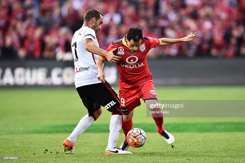 Romeo Castelen of the Wanderers and Sergio Cirio of United competes for the ball during the 2015/16 A-League Grand Final match between Adelaide United and the Western Sydney Wanderers at Adelaide Oval on May 1, 2016 in Adelaide, Australia.