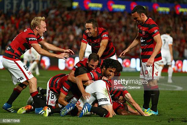 Romeo Castelen of the Wanderers celebrates scoring a goal with team mates during the ALeague Semi Final match between the Western Sydney Wanderers...