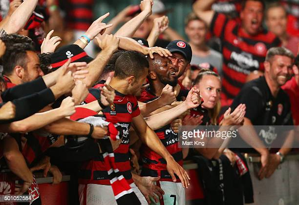 Romeo Castelen of the Wanderers celebrates with team mates and fans after scoring their second goal during the round 10 ALeague match between the...