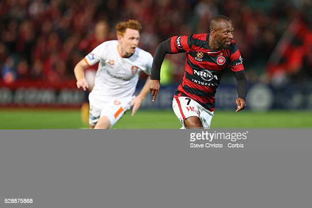 Romeo Castelen of the Wanderers gets passed Brisbane's Steven Lustica during the round one ALeague match between the Western Sydney Wanderers and the...