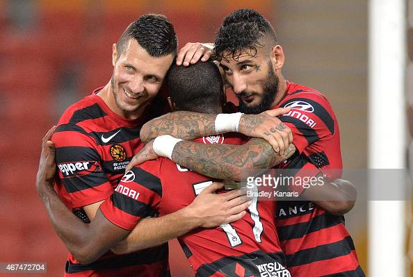 Romeo Castelen of the Western Sydney Wanderers celebrates with team mates after scoring a goal during the round 21 ALeague match between Brisbane...