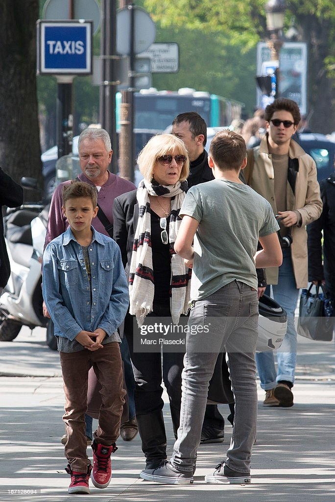 Romeo James Beckham, Jackie Adams and Brooklyn Joseph Beckham are seen arriving at the 'Matignon' restaurant on April 21, 2013 in Paris, France.