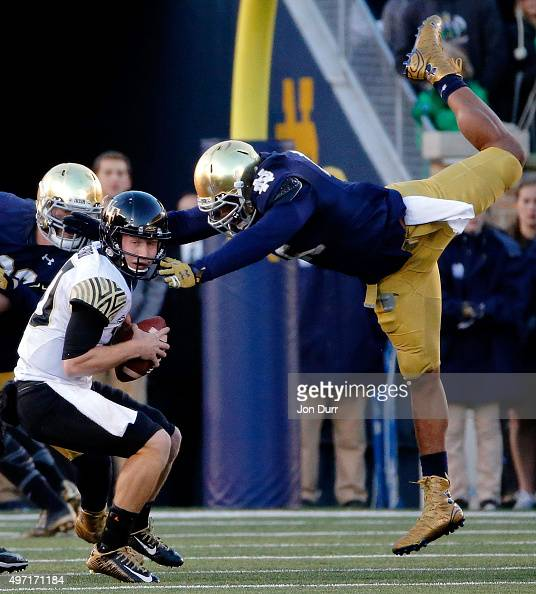 Romeo Okwara of the Notre Dame Fighting Irish leaps through the air to sack John Wolford of the Wake Forest Demon Deacons during the second quarter...