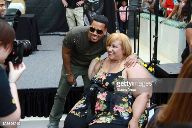 Romeo Santos greets fans during the InStore event as part of the promo of his new album 'Golden' at The Mall of San Juan on July 27 2017 in San Juan...