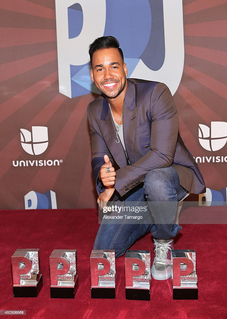 <a gi-track='captionPersonalityLinkClicked' href=/galleries/search?phrase=Romeo+Santos&family=editorial&specificpeople=4103984 ng-click='$event.stopPropagation()'>Romeo Santos</a> poses in the press room during the Premios Juventud 2014 at The BankUnited Center on July 17, 2014 in Coral Gables, Florida.