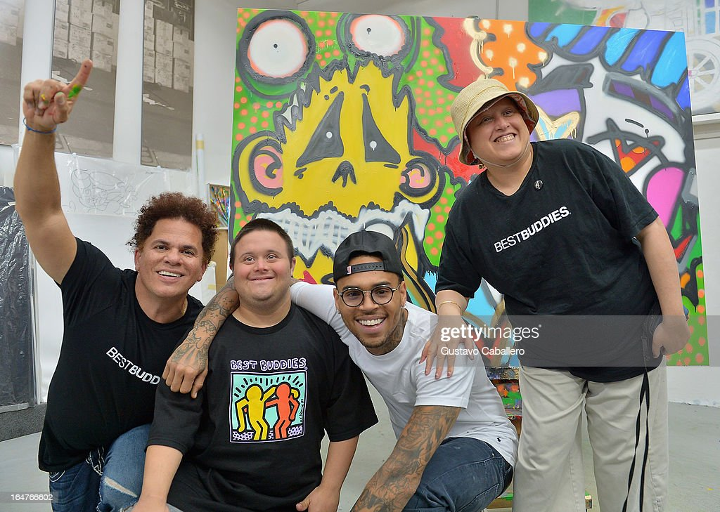 <a gi-track='captionPersonalityLinkClicked' href=/galleries/search?phrase=Romero+Britto&family=editorial&specificpeople=636637 ng-click='$event.stopPropagation()'>Romero Britto</a>, Chris Gay, Chris Brown and Samiha Dossus attend the Chris Brown joins forces with artist <a gi-track='captionPersonalityLinkClicked' href=/galleries/search?phrase=Romero+Britto&family=editorial&specificpeople=636637 ng-click='$event.stopPropagation()'>Romero Britto</a> in support of Best Buddies International event on March 27, 2013 in Miami, Florida.