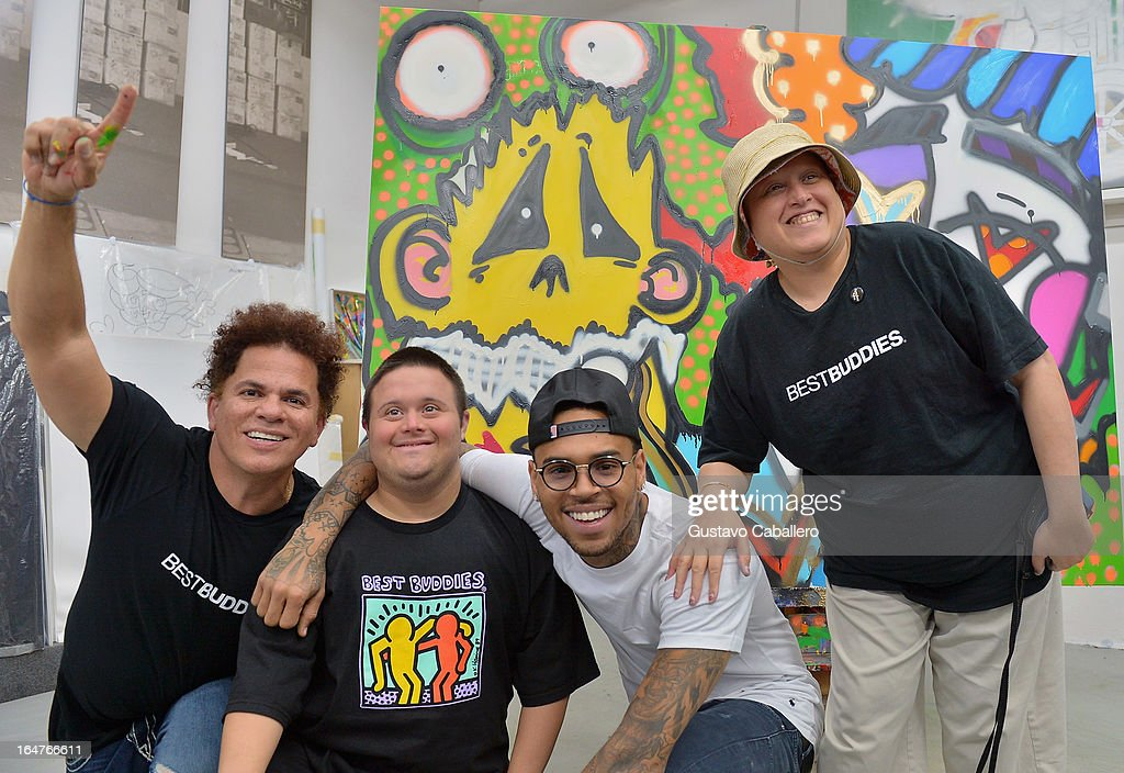 Romero Britto, Chris Gay, Chris Brown and Samiha Dossus attend the Chris Brown joins forces with artist Romero Britto in support of Best Buddies International event on March 27, 2013 in Miami, Florida.