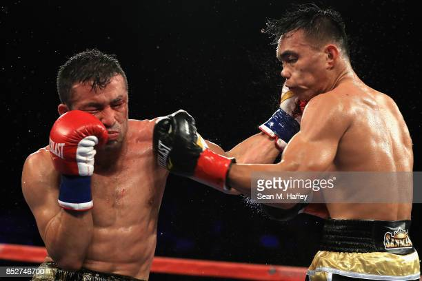 Romero Duno of the Philippines exchanges punches with Juan Sanchez of Mexico during their lightweight bout at The Forum on September 23 2017 in...