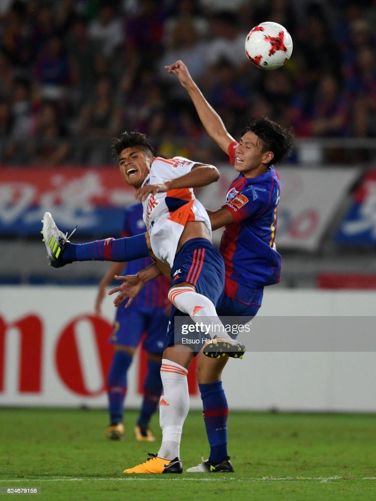 Romero Frank (L) of Albirex Niigata and Kento Hashimoto of FC Tokyo compete for the ball during the J.League J1 match between FC Tokyo and Albirex Niigata at Ajinomoto Stadium on July 30, 2017 in Chofu, Tokyo, Japan.