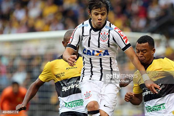 Romero of Corinthians in action during a match between Criciuma and Corinthians as part of Campeonato Brasileiro 2014 at Heriberto Hulse Stadium on...