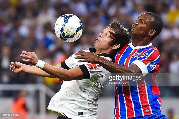 Romero of Corinthians struggles for the ball with a Adailton of Bahia during a match between Corinthians and Bahia as part of Copa do Brasil 2014 at...