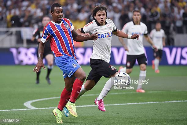 Romero of Corinthians struggles for the ball with a Guilherme Santos of Bahia during a match between Corinthians and Bahia as part of Copa do Brasil...