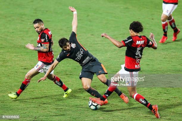 Romero of Corinthians struggles for the ball with a Para and William Arao of Flamengo during the Brasileirao Series A 2017 match between Flamengo and...