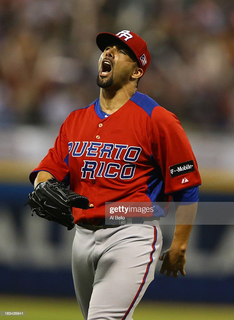<a gi-track='captionPersonalityLinkClicked' href=/galleries/search?phrase=J.C.+Romero&family=editorial&specificpeople=225049 ng-click='$event.stopPropagation()'>J.C. Romero</a> #32 of Puerto Rico celebrates after retiring the side after the eighth inning against Venezuela during the first round of the World Baseball Classic at Hiram Bithorn Stadium on March 9, 2013 in San Juan, Puerto Rico.
