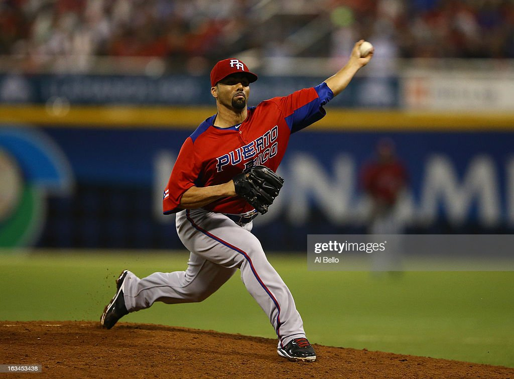 C Romero of Puerto Rico in action against Venezuela during the first round of the World Baseball Classic at Hiram Bithorn Stadium on March 9 2013 in...