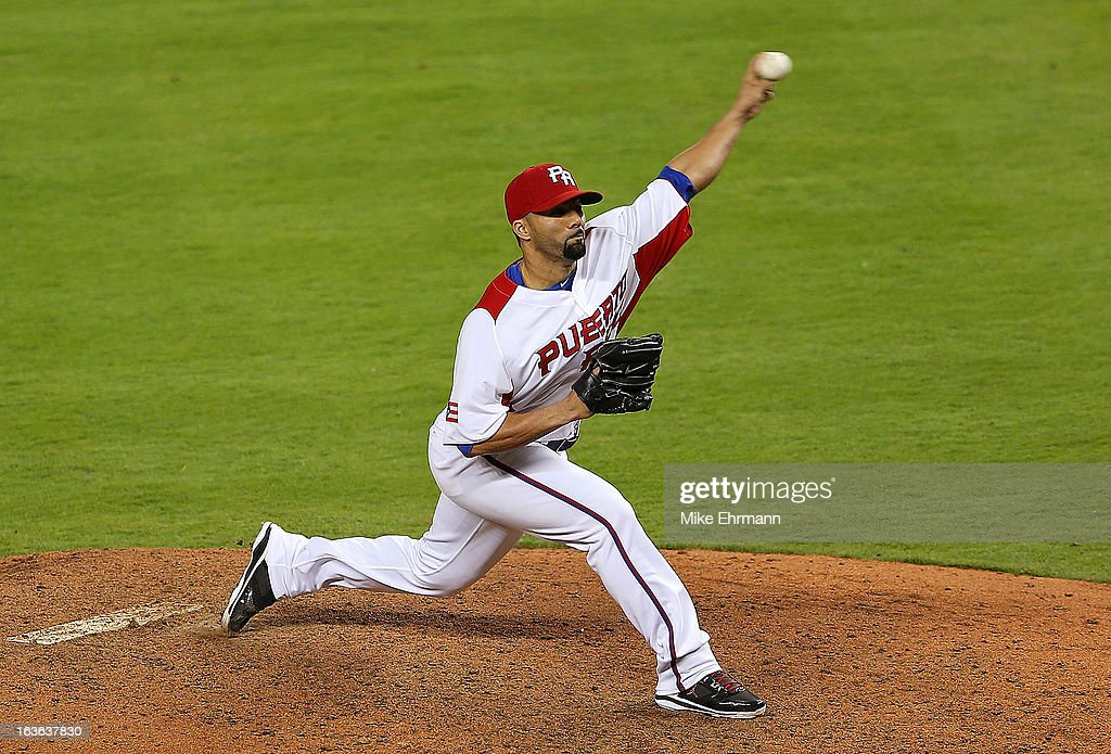 C Romero of Puerto Rico pitches during a World Baseball Classic second round game against Italy at Marlins Park on March 13 2013 in Miami Florida