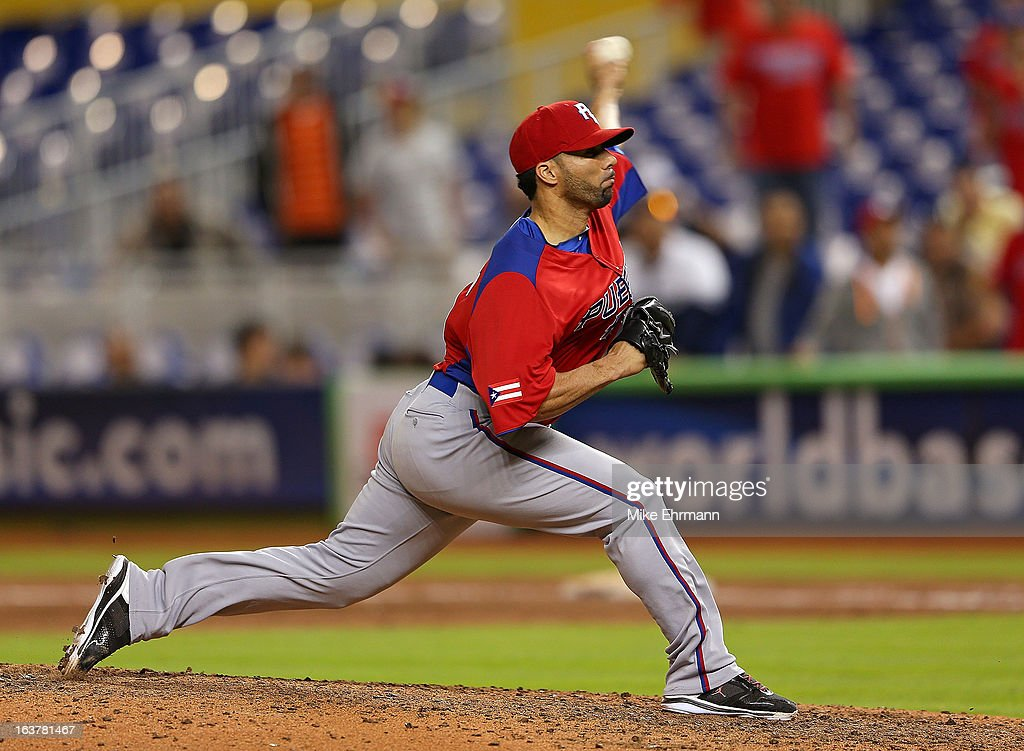 J.C. Romero #32 of Puerto Rico pitches during a World Baseball Classic second round game against the United States at Marlins Park on March 15, 2013 in Miami, Florida.