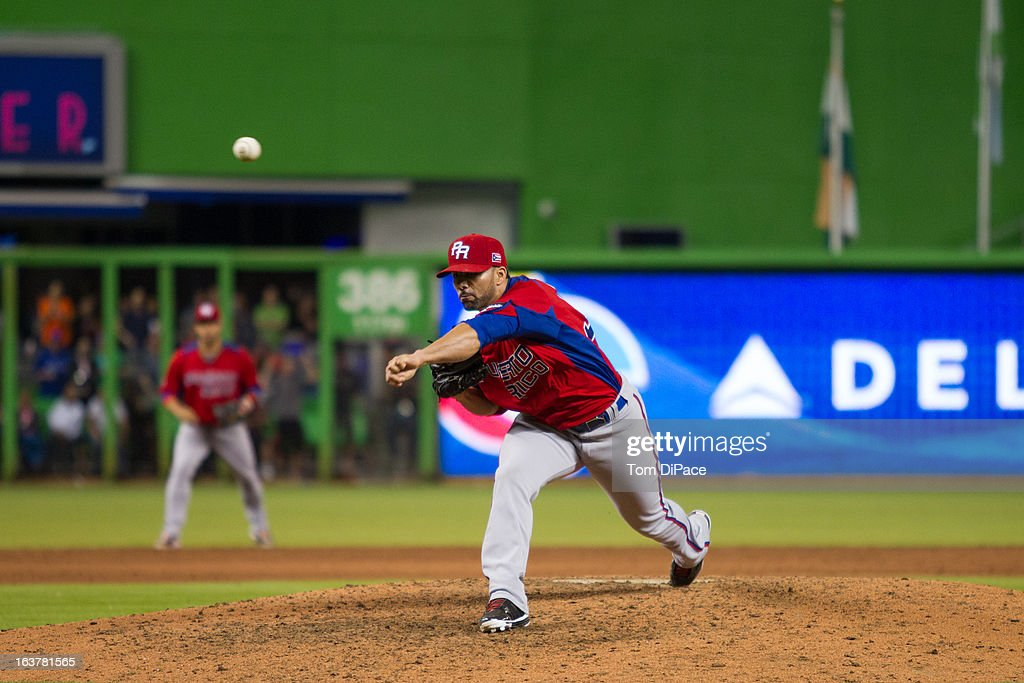 J.C. Romero #32 of Team Puerto Rico pitches during Pool 2, Game 4 against Team USA in the second round of the 2013 World Baseball Classic on Friday, March 15, 2013 at Marlins Park in Miami, Florida.