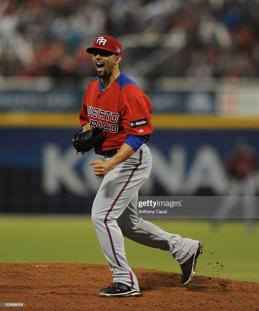 C Romero of Team Puerto Rico reacts to striking out Pablo Sandoval of Team Venezuela to end the eighth inning during Pool C Game 4 in the first round...