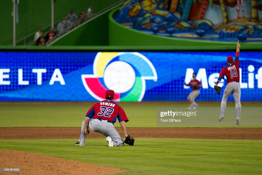 C Romero of Team Puerto Rico watches Angel Pagan make the catch for the final out of Pool 2 Game 4 against Team USA in the second round of the 2013...
