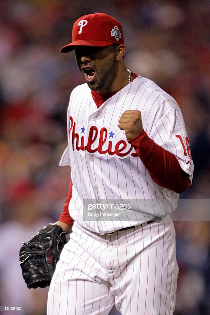 C Romero of the Philadelphia Phillies celebrates getting the last out of the eigth inning against the Tampa Bay Rays during game three of the 2008...