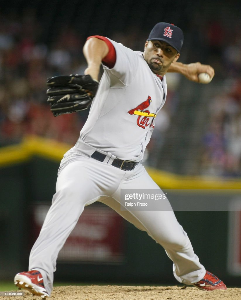 C Romero of the St Louis Cardinals delivers a pitch against the Arizona Diamondbacks during a MLB game at Chase Field on May 7 2012 in Phoenix Arizona