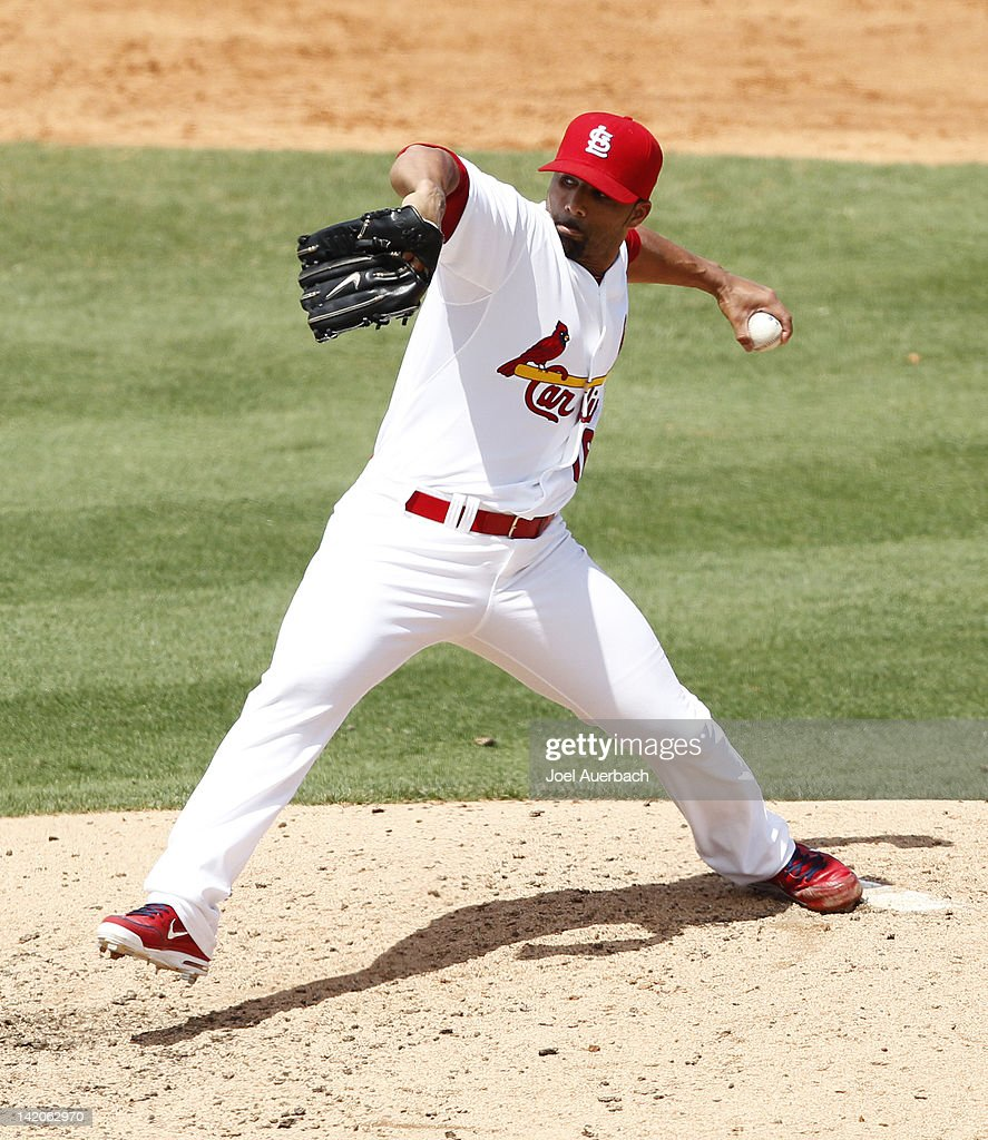 C Romero of the St Louis Cardinals throws the ball against the Detroit Tigers during a Grapefruit League spring training game at Roger Dean Stadium...