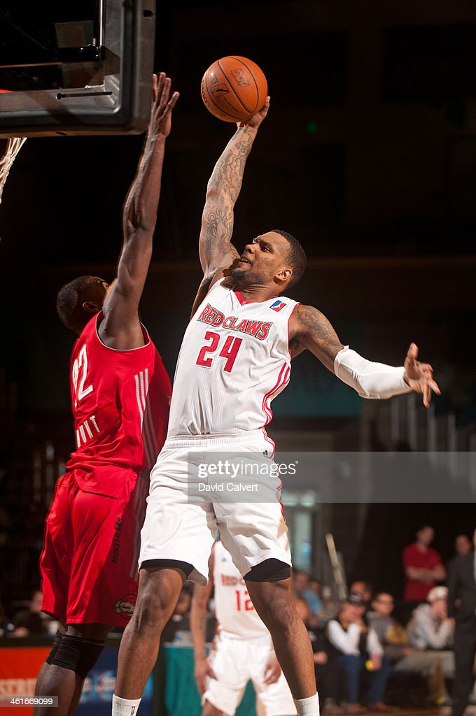 <a gi-track='captionPersonalityLinkClicked' href=/galleries/search?phrase=Romero+Osby&family=editorial&specificpeople=5757556 ng-click='$event.stopPropagation()'>Romero Osby</a> #24 of the Maine Red Claws attempts a dunk over Dario Hunt #22 of the Rio Grande Valley Vipers during the 2014 NBA D-League Showcase on January 8, 2014 at the Reno Events Center in Reno, Nevada.