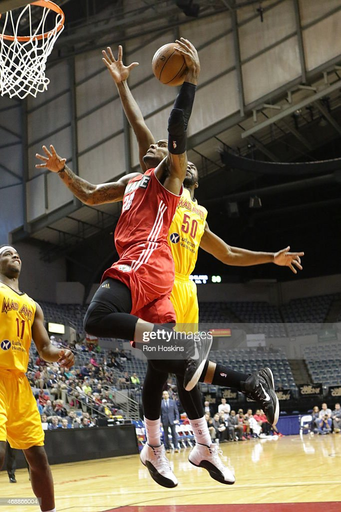 <a gi-track='captionPersonalityLinkClicked' href=/galleries/search?phrase=Romero+Osby&family=editorial&specificpeople=5757556 ng-click='$event.stopPropagation()'>Romero Osby</a> #23 of the Maine Red Claws lays the ball up on a Mad Ants defender during their NBDL game at Memorial Coliseum April 7, 2015 in Fort Wayne, Indiana.