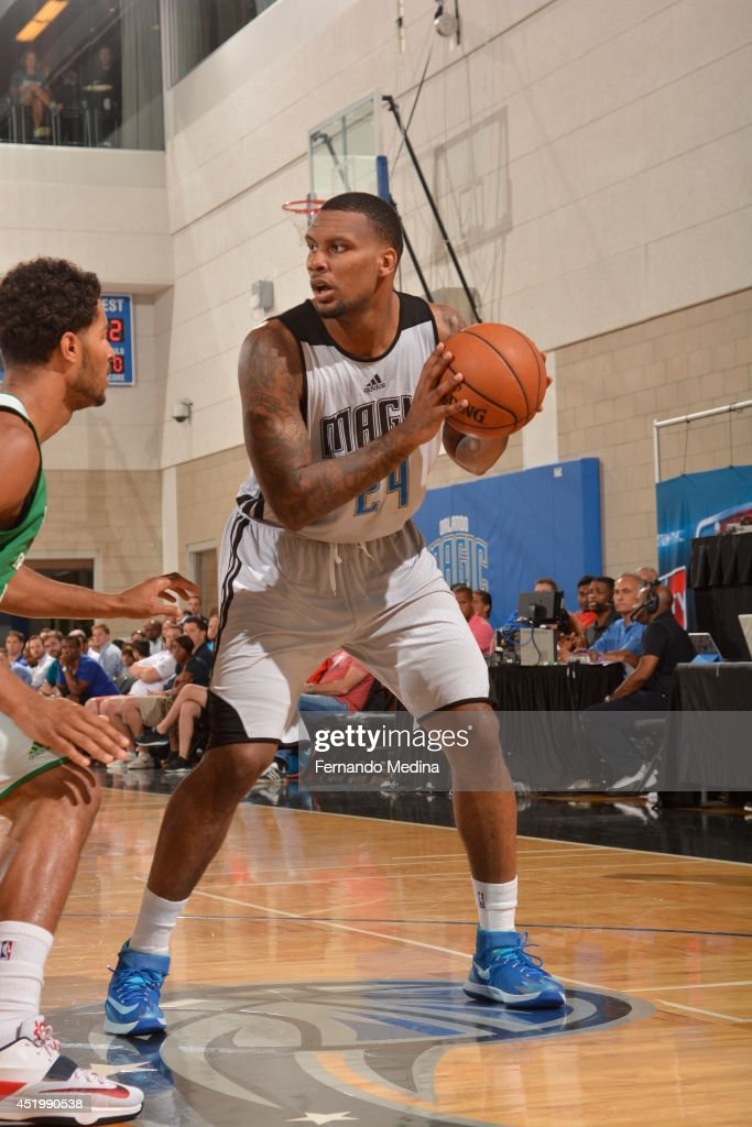 <a gi-track='captionPersonalityLinkClicked' href=/galleries/search?phrase=Romero+Osby&family=editorial&specificpeople=5757556 ng-click='$event.stopPropagation()'>Romero Osby</a> #24 of the Orlando Magic looks to make a play with the ball against the Boston Celtics during the Samsung NBA Summer League 2014 on July 10, 2014 at Amway Center in Orlando, Florida.