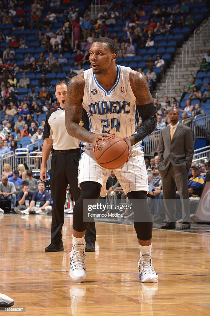 <a gi-track='captionPersonalityLinkClicked' href=/galleries/search?phrase=Romero+Osby&family=editorial&specificpeople=5757556 ng-click='$event.stopPropagation()'>Romero Osby</a> #24 of the Orlando Magic looks to pass the ball against the New Orleans Pelicans the game on October 25, 2013 at Amway Center in Orlando, Florida.