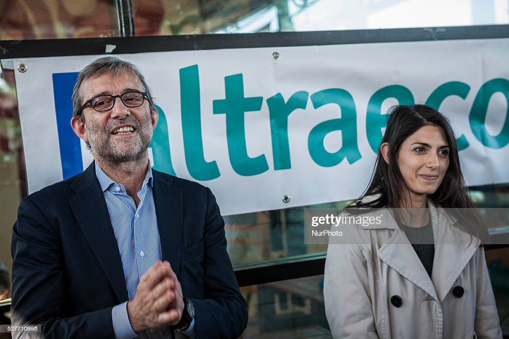 Rome's city council mayoral candidates Roberto Giachetti (L) and Virginia Raggi (R) attend a public debate in Rome, Italy on May 03, 2016.